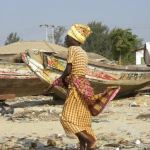 Africa woman shopping on the beach